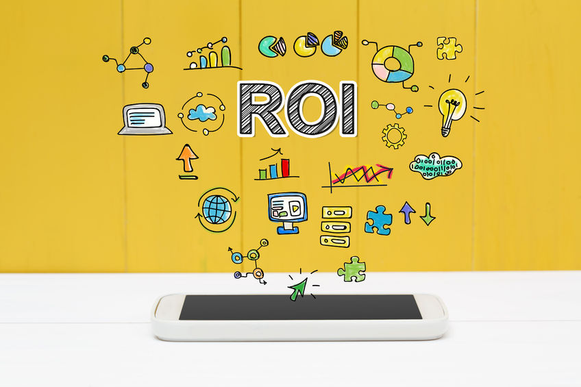 53676707 - roi concept with smartphone on yellow wooden background