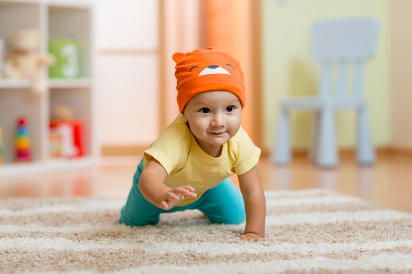 47430319 - baby boy at home crawling on carpet
